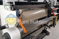 Mounting and proofing machine for mounting flexo plates on cylinders and/or sleeves for printing presses in plastic film and paper industries.
